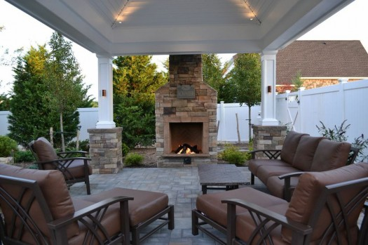Outdoor Fireplace: At the edge of a patio, beside a lovely shingle-roof gazebo/pergola, this fireplace not only offers warmth in autumn and winter months but it creates the perfect ambience for conversation.