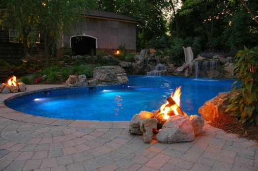 Natural Gas Campfires: If one campfire is good, two or more is even better. Note how outdoor breezes blow across the natural gas flames to create warm puffs of air and how the soft flickering light dances across the pool.
