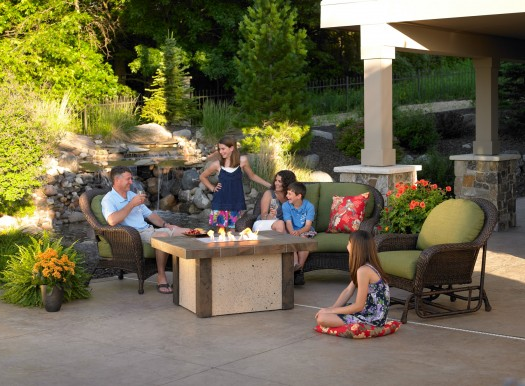 Outdoor Family Fun: While we may no longer be hunter-gatherers like our ancestors, we are definitely still gatherers. This non-custom fire pit was easy to install next to a custom waterfall. Talk about outdoor primeval enjoyments. Photo: Outdoor Great Room Company