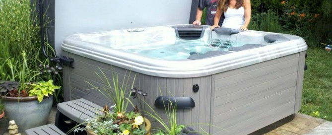 "Best Hot Tubs Clients (Long Island/NY): These happy hot tub clients created an easy ""set-in-garden"" look with a few plant containers for their new Bullfrog Spa. Nice, yes?"