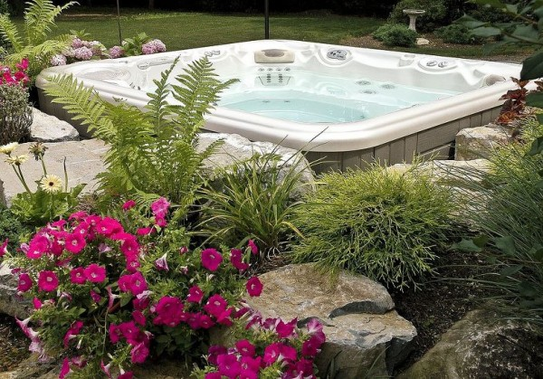 Hot Tub Set-in-Garden Installation: Here is a close up of the second project. One reason for choosing this type of custom installation is the ability to add one's favorite flowers. In the right season, the flowers can add sweet-smelling aroma therapy to already wonderful hydrotherapy of a Bullfrog Spa.