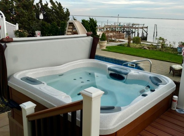 """Bullfrog Spas Interiors: The handsome """"Sandstone"""" interior chosen by our clients shines beautifully in clean hot tub water."""