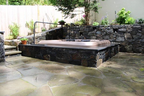 Hot Tub Set in Vault with Granite Stone Facade