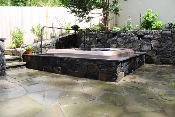 Hot Tub Set in Vault with Granite Stone Facade: